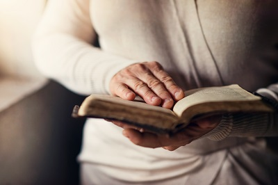 woman praying with bible small